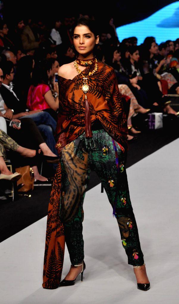 Karachi (Pakistan): A model presents a creation by designer Sadaf Malaterre on the last day of Pakistan Fashion Week in southern Pakistani port city of Karachi on Nov. 27, 2014. The three-day ...