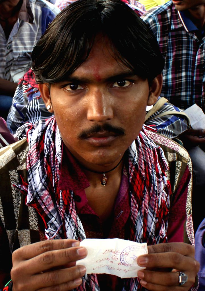Karachi (Pakistan): An Indian fisherman sits outside a jail after his release in southern Pakistani port city of Karachi on Nov. 28, 2014. Pakistan on Friday released 36 Indian fishermen and a ...