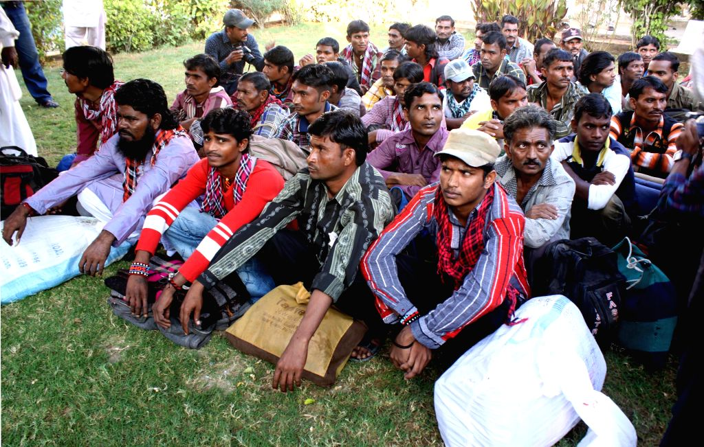 Karachi (Pakistan): Indian fishermen sit outside of a jail after their release in southern Pakistani port city of Karachi, Nov. 28, 2014. Pakistan on Friday released 36 Indian fishermen and a ...
