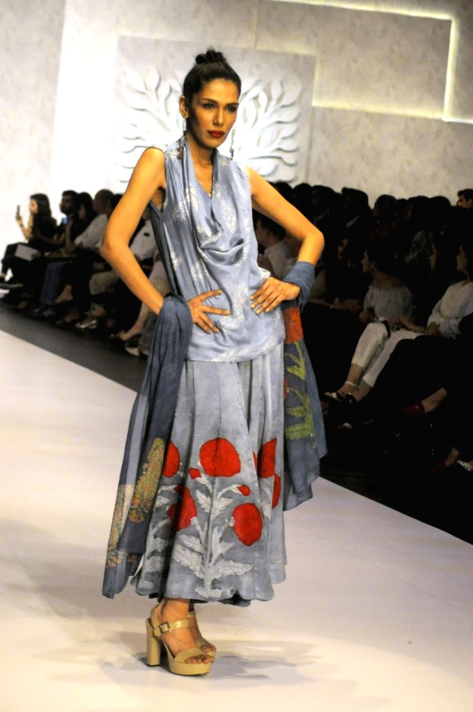 KARACHI (PAKISTAN), March 29, 2018 A model presents a creation by designer Faiza on the second day of the Hum Showcase fashion event in southern Pakistani port city of Karachi, on March ...