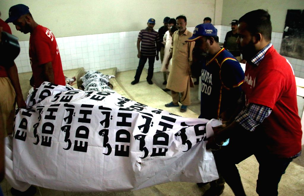 KARACHI (PAKISTAN), Sept. 4, 2017 Rescuers transfer a body of a terrorist to a hospital in southern Pakistani port city of Karachi, on Sept. 4, 2017. Police in the Pakistani port city of ...