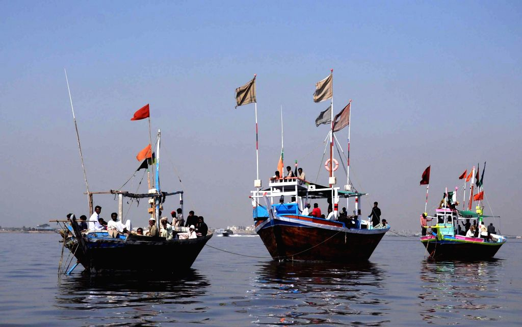 Pakistani fishermen leave for fishing in shallow waters of a sea along the Karachi coast, in southern Pakistani port city of Karachi, on Nov. 22, 2014.