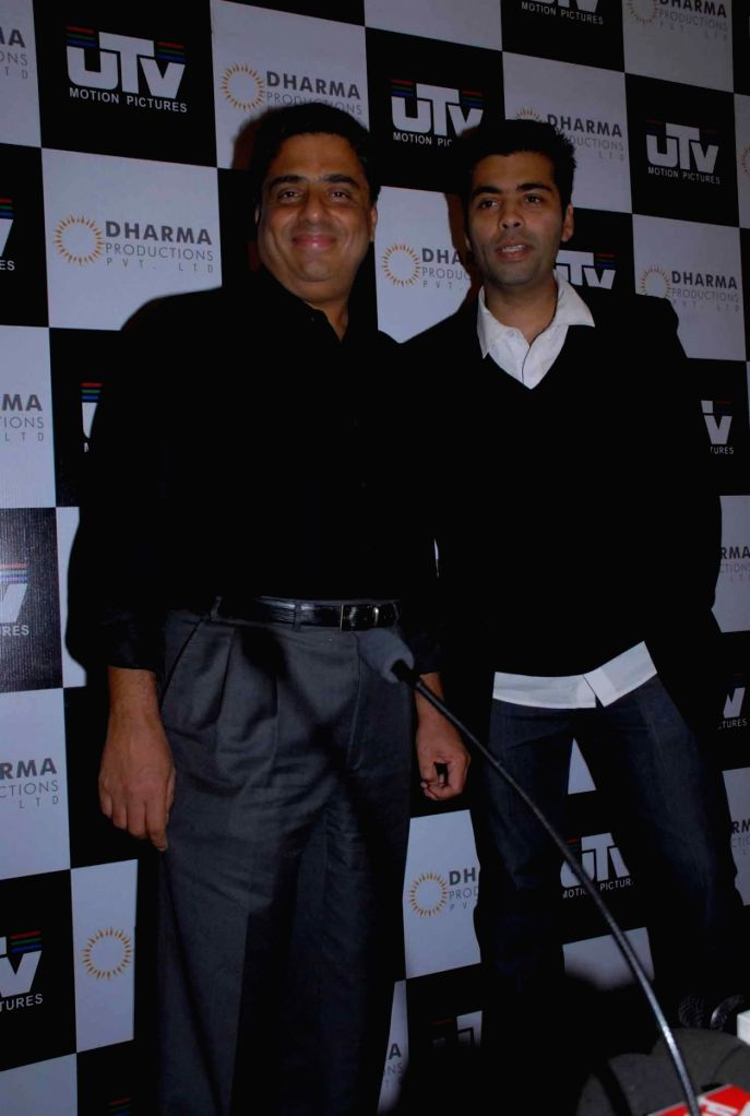 Karan Johar with Ronni Screwalla at press meet to announce partnership between UTV and Dharma Productions.