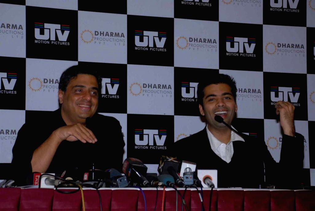 Karan Johar with Ronni Screwalla at press meet to announce partnership between UTV and Dharma Productions.