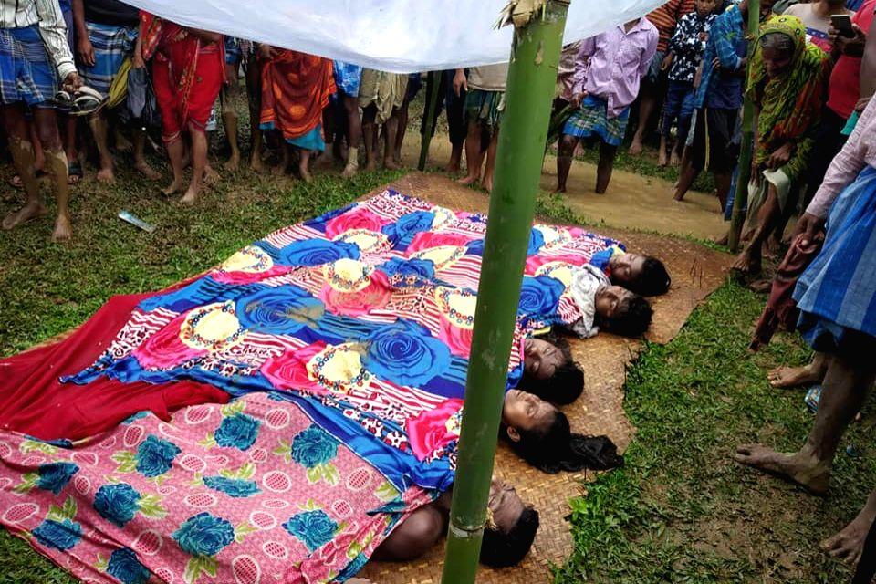 Karimganj: Bodies of a family that was killed in a landslide at Kaliganj village in Karimganj district of Assam on June 2, 2020. At least 20 people, including three children, were killed in three separate landslides in southern Assam on Tuesday. (Pho