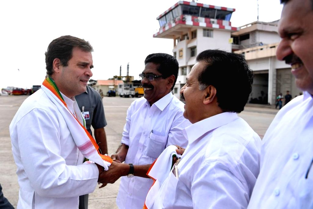 Karipur: Congress President Rahul Gandhi being welcomed by party workers on his arrival at the Kozhikode International Airport in Karipur, Kerala on June 7, 2019. He is on a three-day visit to his parliamentary constituency Wayanad in Kerala. This is - Rahul Gandhi