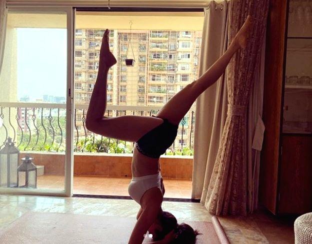 Karishma Tanna aces the inversion yoga pose.