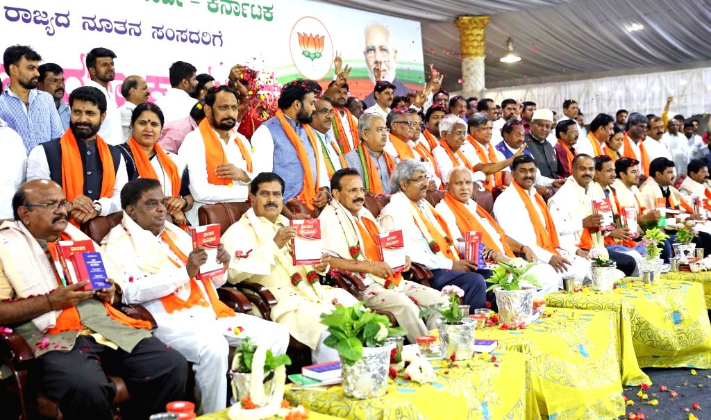Karnataka BJP chief B. S. Yeddyurappa and other party leaders with newly elected BJP MPs from Karnataka during a felicitation programme in Bengaluru on June 5, 2019.
