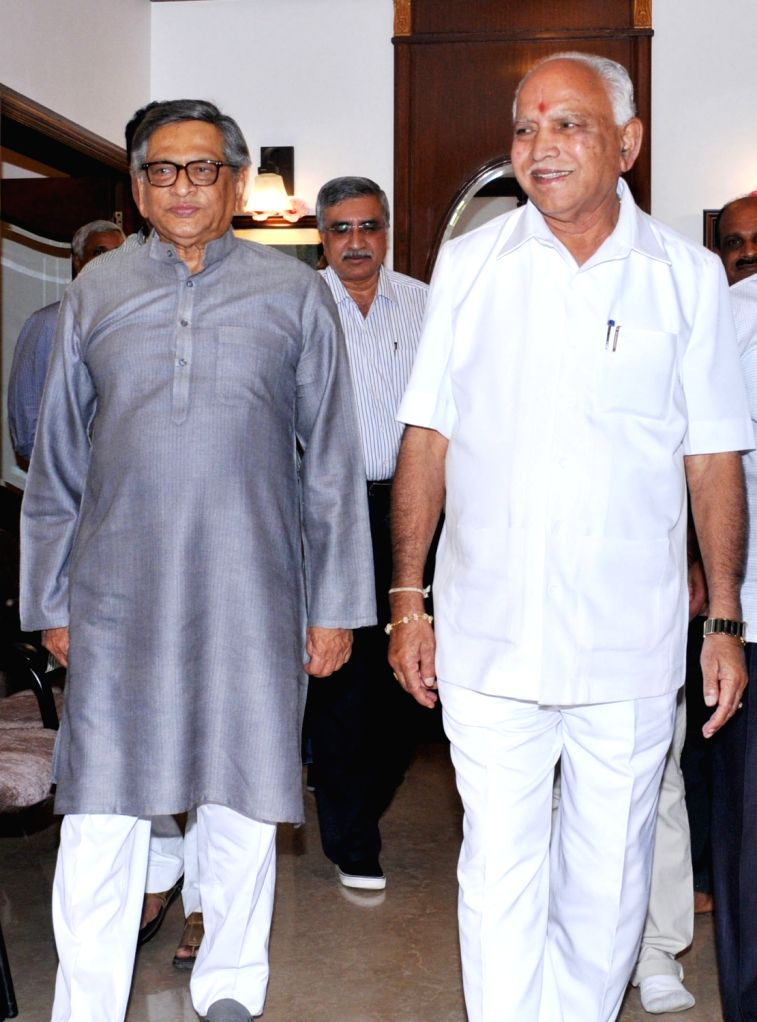 Karnataka BJP chief BS Yeddyurappa meets Congress veteran SM Krishna in Bengaluru on March 6, 2017.