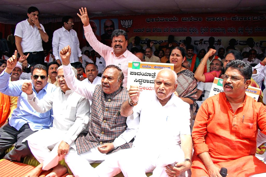 Karnataka BJP chief BS Yeddyurappa stage a demonstration against the state government over Jindal land deal in Bengaluru on June 14, 2019.