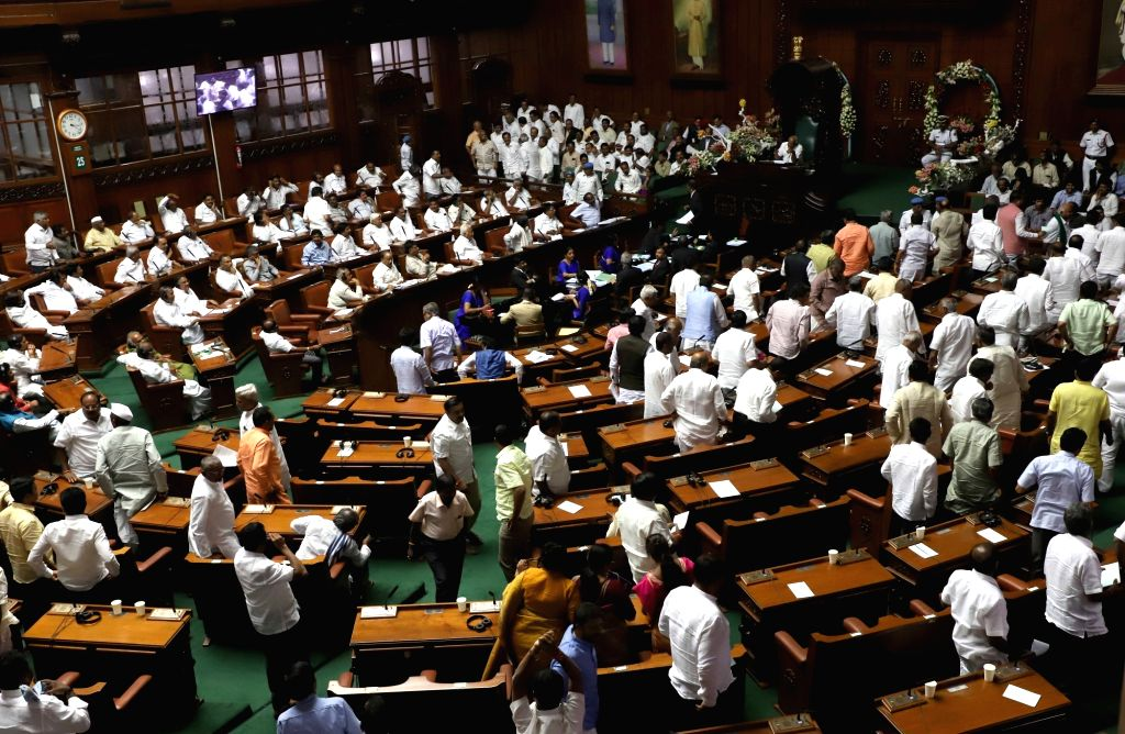 Karnataka BJP legislators walk out of the state assembly ahead of the trust vote moved by Chief Minister H.D. Kumaraswamy in the House, in Bengaluru on May 25, 2018. - H.