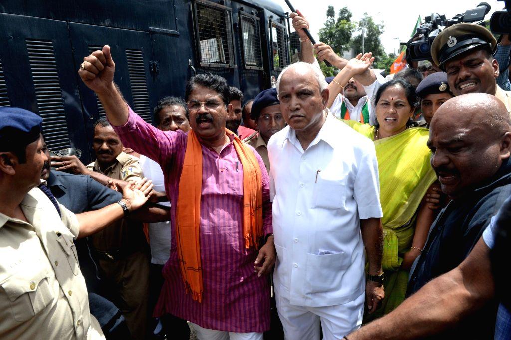 Karnataka BJP president B. S. Yeddyurappa along with BJP legislator R. Ashoka during BJP's demonstration in Bengaluru on Aug 18, 2017.