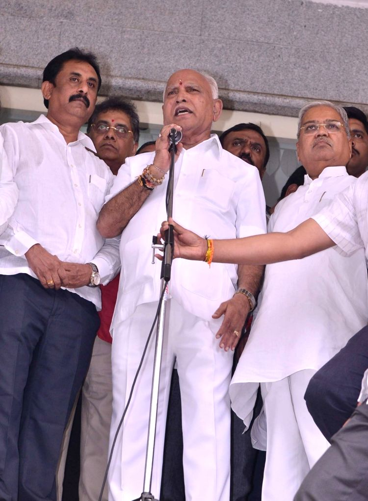 Karnataka BJP President B. S. Yediyurappa addresses party workers at state party headquarters ahead of taking oath as the new Chief Minister, in Bengaluru on July 26, 2019.