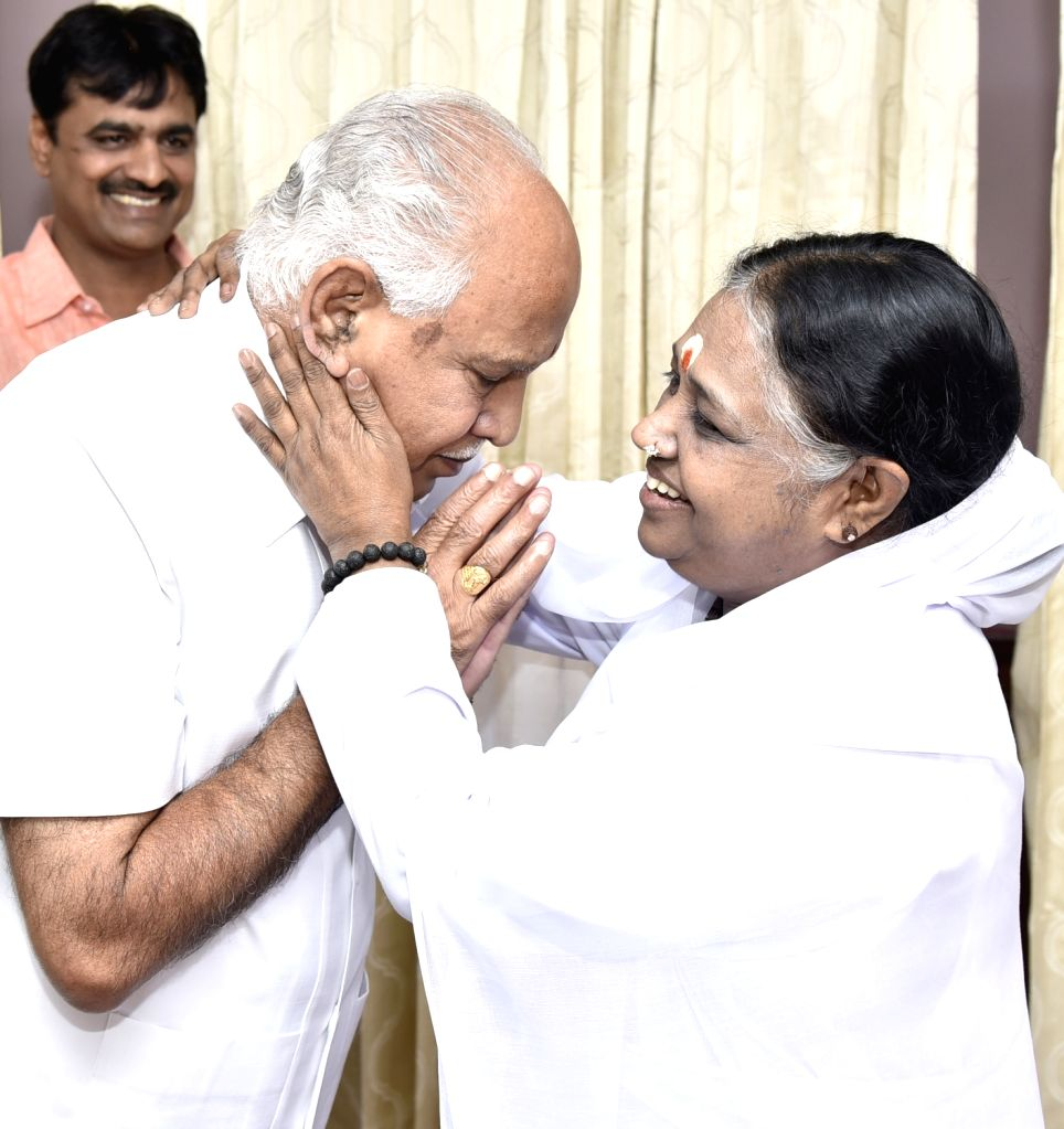Karnataka BJP President BS Yeddiyurappa takes blessing from Spiritual leader Mata Amritanandamayi during his visit to Mata Amritanandamayi Ashram, in Bengaluru on March 9, 2017.
