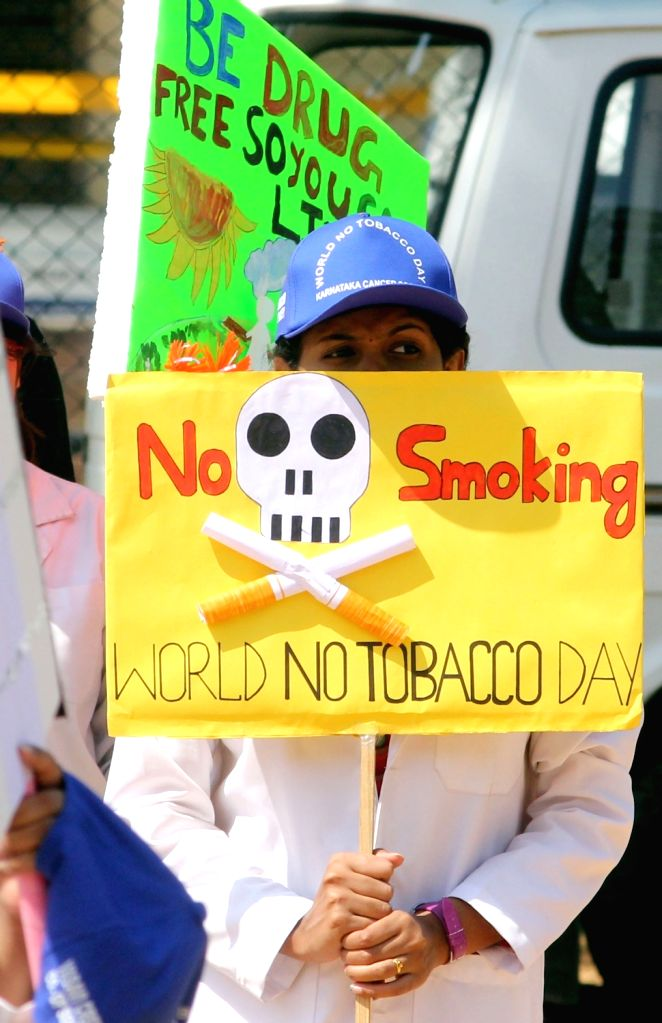 "Karnataka Cancer Society members participate during an awareness rally on ""World No Tobacco Day"" in Bengaluru, on May 31, 2016."