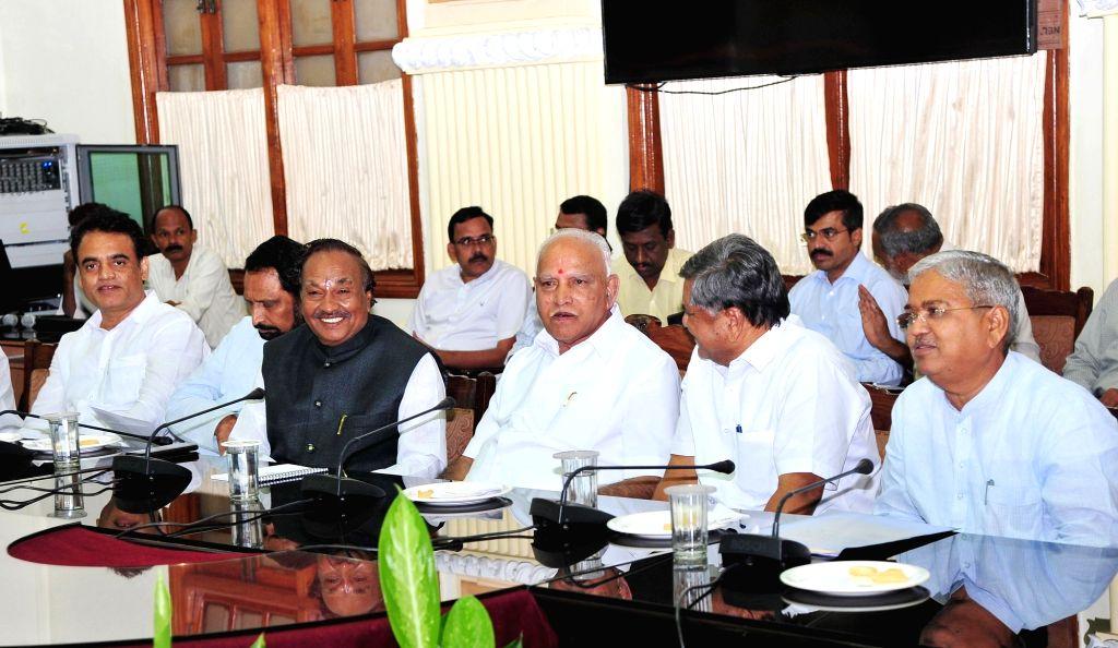 Karnataka Chief Minister B.S. Yeddiyurappa, Deputy Chief Ministers Govind M Karjola, Lakshman Savadi and Ashwath Narayan during a BJP meeting at Vidhana Soudha, in Bengaluru on Oct 9, 2019. - B., Govind M Karjola, Lakshman Savadi and Ashwath Narayan