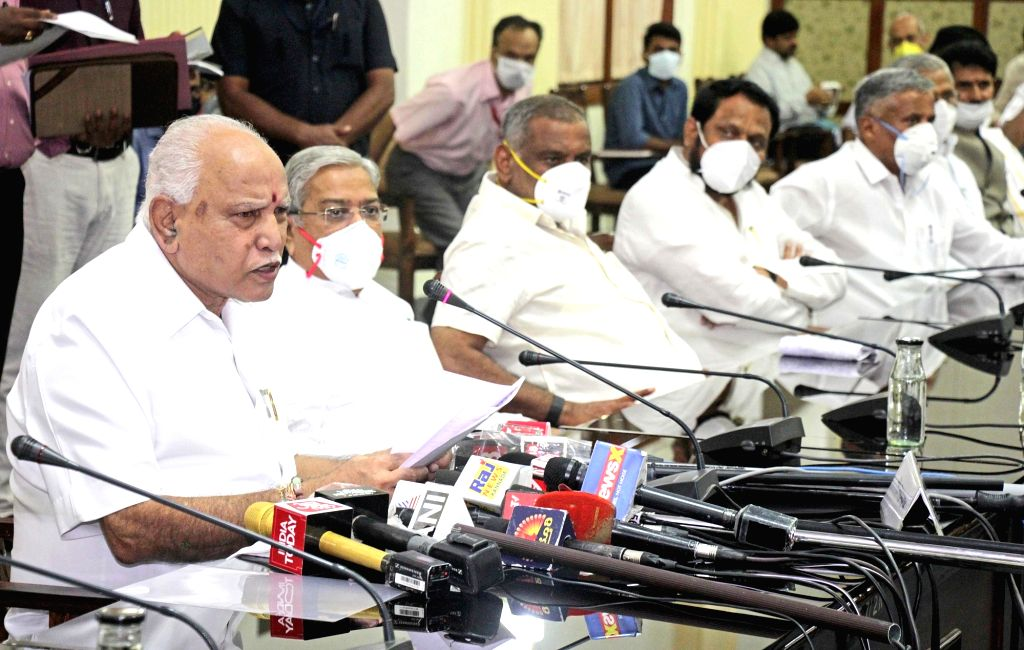 Karnataka Chief Minister B. S. Yediyurappa addresses a press conference at Vidhana Soudha in Bengaluru during the extended nationwide lockdown imposed to mitigate the spread of ... - B. S. Yediyurappa