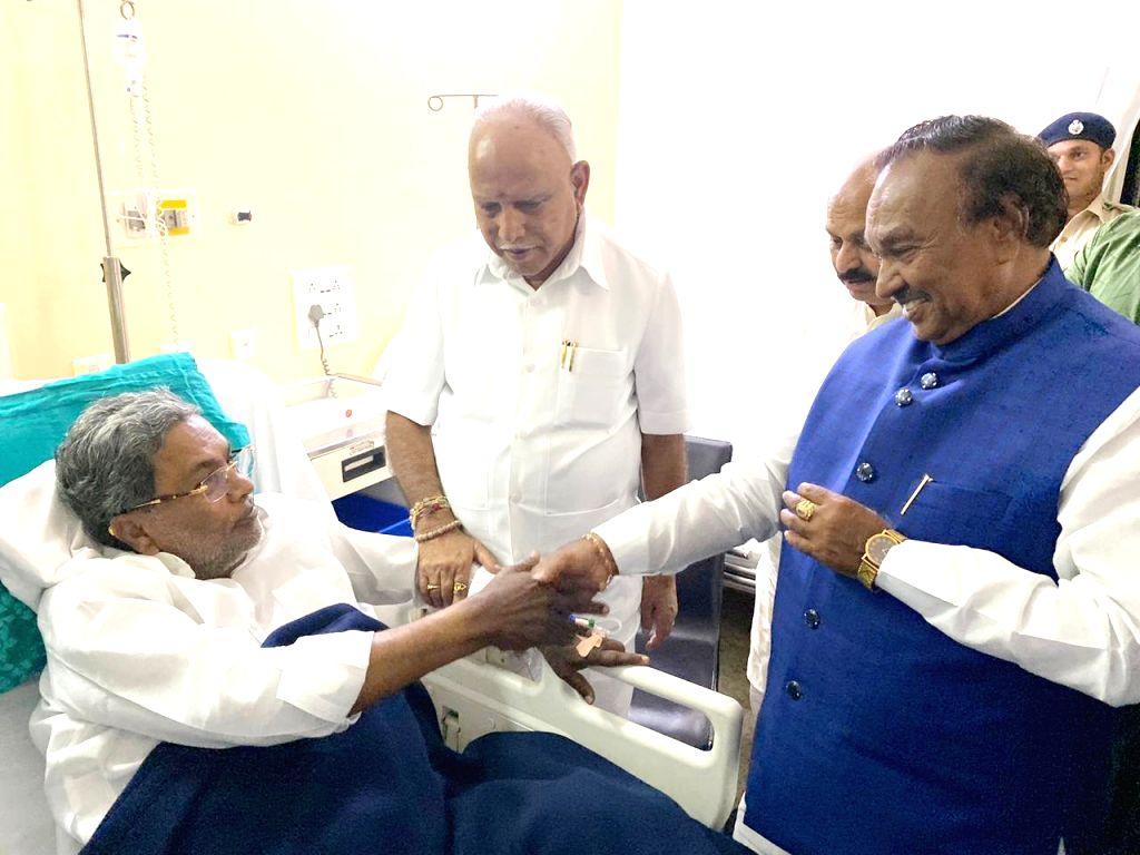 Karnataka Chief Minister B. S. Yediyurappa, Ministers Basavaraj Bommai and KS Eshwarappa inquire about the health of Congress leader Siddaramaiah at a private hospital, in Bengaluru on Dec ... - B. S. Yediyurappa, Basavaraj Bommai and K