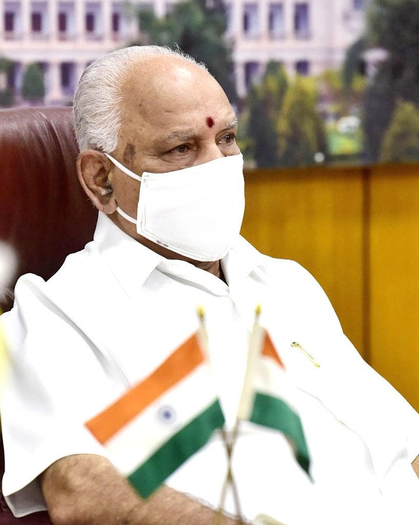 Karnataka Chief Minister B S Yediyurappa attends the 4th interaction with Chief Ministers of all states and Union territories chaired by Prime Minister Narendra Modi through video ... - B S Yediyurappa and Narendra Modi