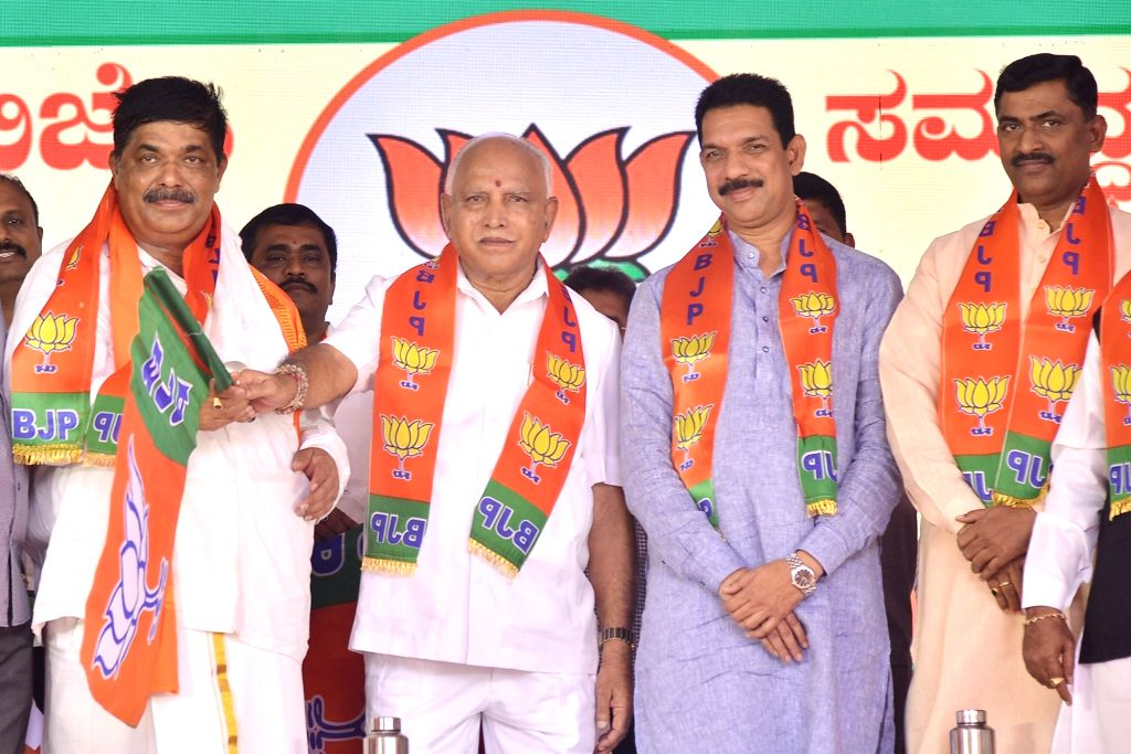 Karnataka Chief Minister B. S. Yediyurappa, BJP State President Nalin Kumar Kateel and party National Secretary Muralidhar Rao hand over the party flag to disqualified MLA Goapaliah during ... - B. S. Yediyurappa, Nalin Kumar Kateel and Secretary Muralidhar Rao