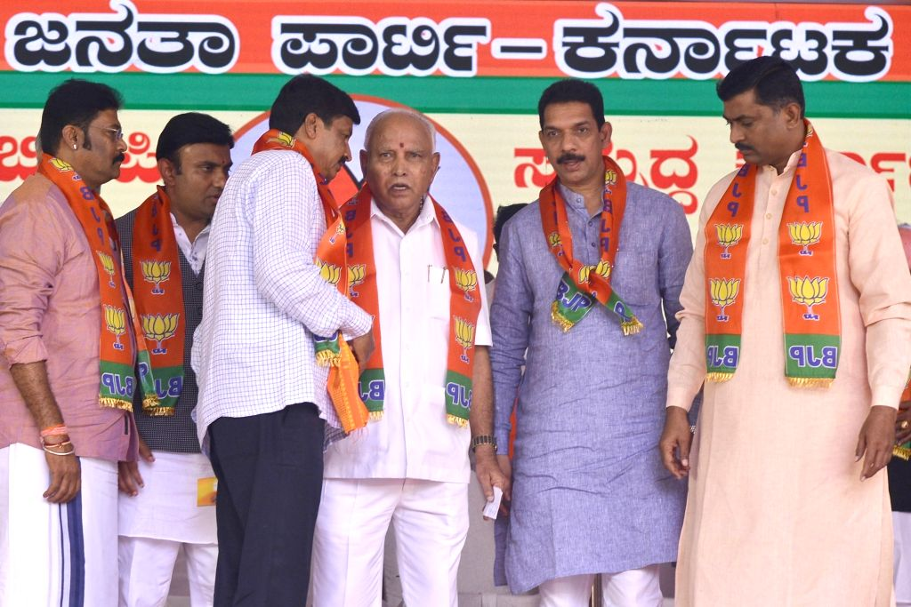 Karnataka Chief Minister B. S. Yediyurappa, BJP State President Nalin Kumar Kateel and party National Secretary Muralidhar Rao with disqualified MLA Mahesh Kumatahalli during a programme ... - B. S. Yediyurappa, Nalin Kumar Kateel and Secretary Muralidhar Rao