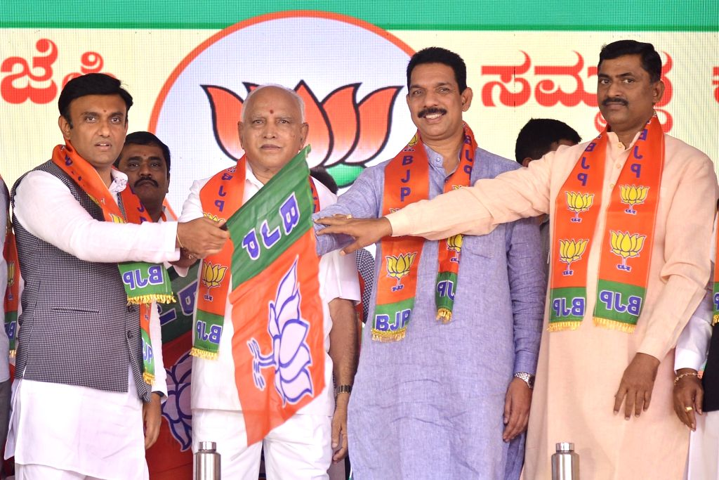 Karnataka Chief Minister B. S. Yediyurappa, BJP State President Nalin Kumar Kateel and party National Secretary Muralidhar Rao hand over the party flag to disqualified MLA Sudhakar during ... - B. S. Yediyurappa, Nalin Kumar Kateel and Secretary Muralidhar Rao