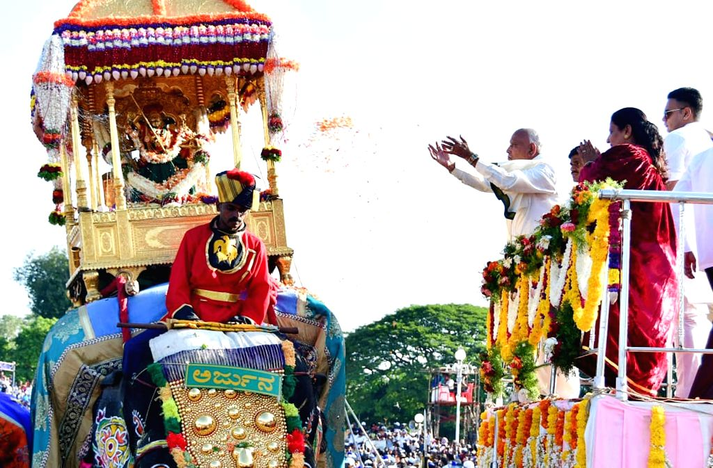 Karnataka Chief Minister B. S. Yediyurappa pays floral tributes to the idol of Sri Chamundeshwari, mounted on the golden howdah, carried by a Dasara elephant to launch the Dasara procession ... - B. S. Yediyurappa