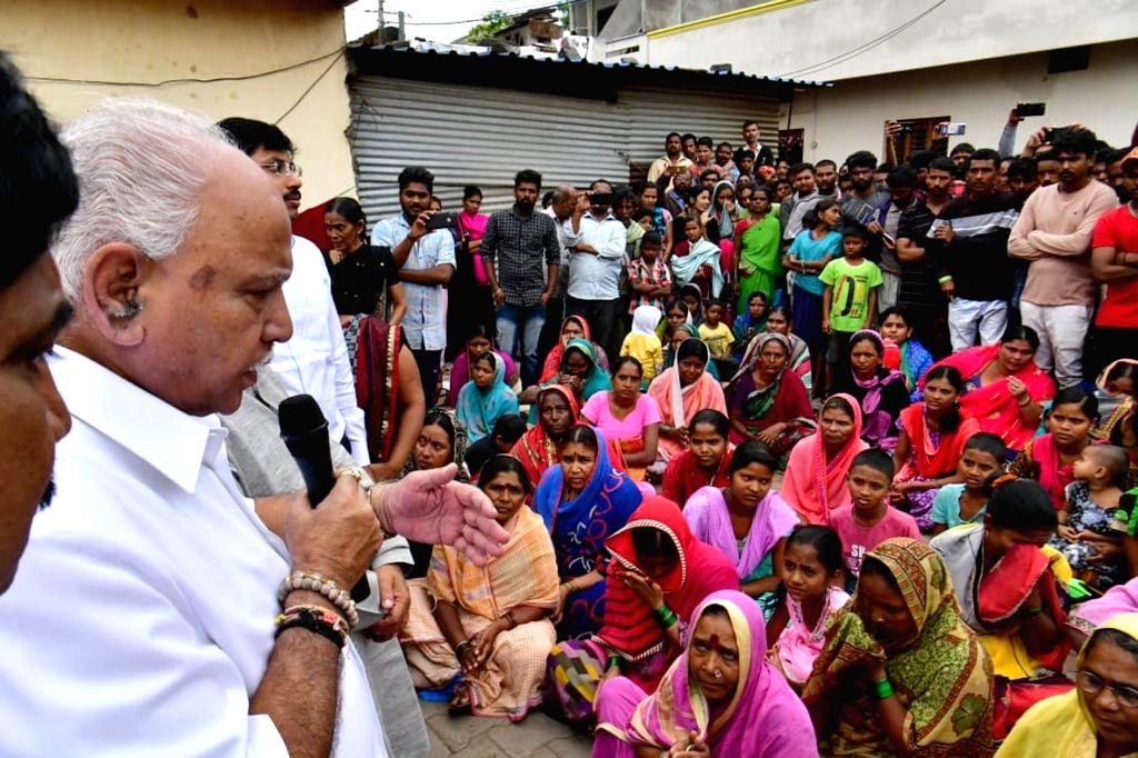 Karnataka Chief Minister B.S. Yediyurappa visits flood hit Gokak in Karnataka's Belagavi district on Aug 9, 2019. - B.