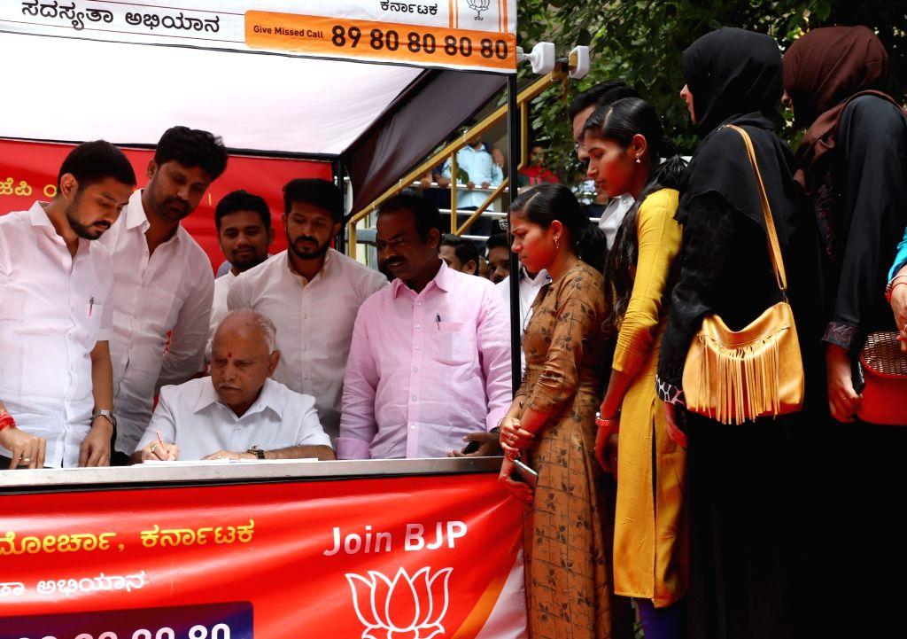 Karnataka Chief Minister B. S. Yediyurappa welcomes people in to the BJP during the party's Membership drive in Bengaluru on Aug 3, 2019. - B. S. Yediyurappa