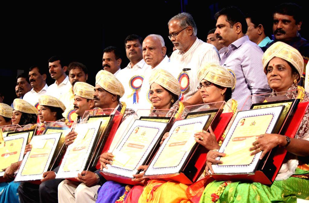 Karnataka Chief Minister B. S. Yediyurappa with the teachers who were felicitated with Best Teachers' Award on the occasion of Teachers' Day, in Bengaluru on Sep 5, 2019. - B. S. Yediyurappa