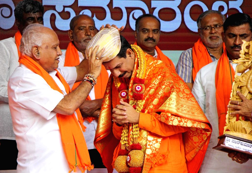 Karnataka Chief Minister BS Yediyurappa felicitates newly appointed State BJP President Nalin Kumar Kateel at party office in Bengaluru on Aug 27, 2019. - B and Nalin Kumar Kateel