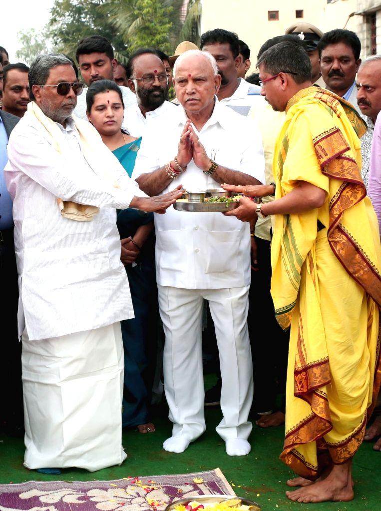 "Karnataka Chief Minister BS Yediyurappa and Congress leader Siddaramaiah at the inauguration of laying foundation stone for the ""Suvarna Bhavana"" in Bengaluru on Nov 10, 2019. - B"