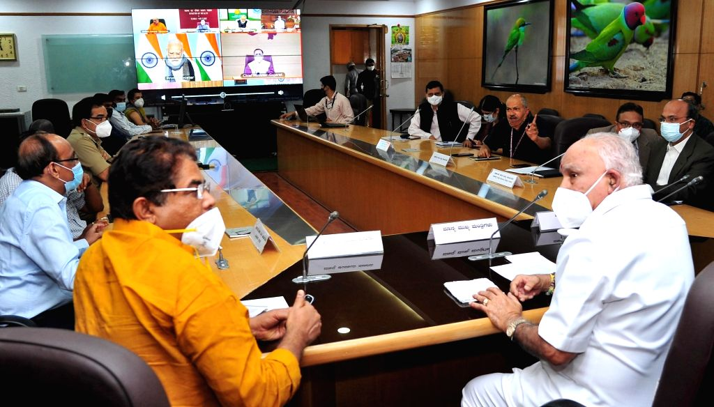 Karnataka Chief Minister BS Yediyurappa attends the high-level meeting chaired by Prime Minister Narendra Modi with Chief Ministers of all States and Union Territories via video ... - B and Narendra Modi
