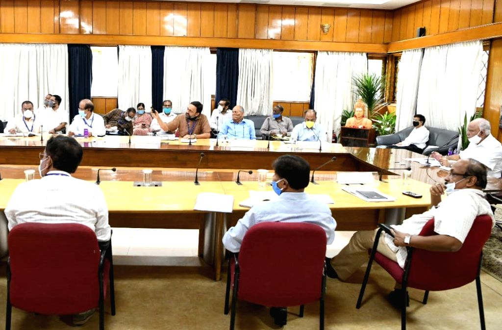Karnataka Chief Minister BS Yediyurappa chairs a review meeting with the Income tax Department at his residence office in Bengaluru during the extended nationwide lockdown imposed to ... - B