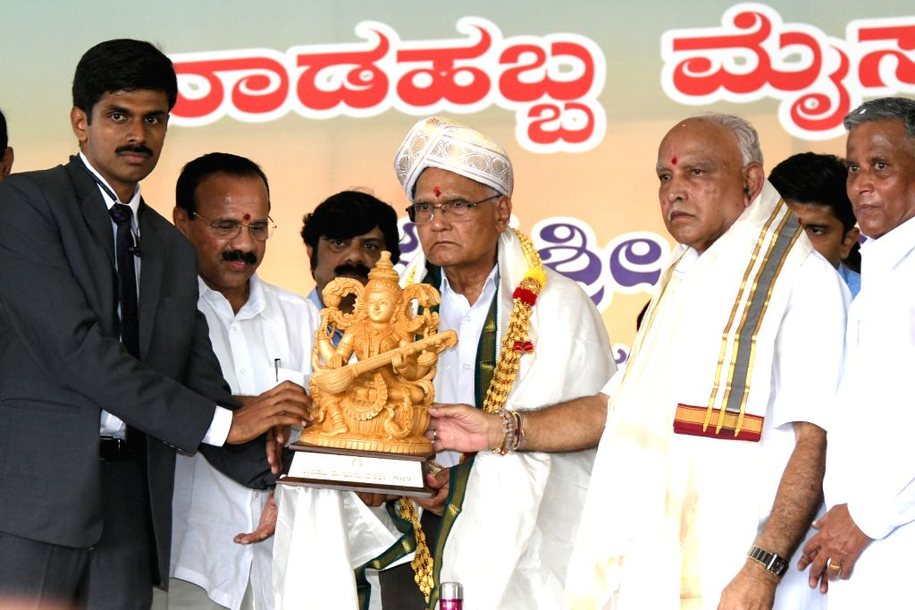 Karnataka Chief Minister BS Yediyurappa, Union Ministers DV Sadananda Gowda, Prahalad Joshi, Chief Guest and Senior Writer SL Bhyrappa, DCM Govind M Karjola and others during the inauguration ... - B and Prahalad Joshi
