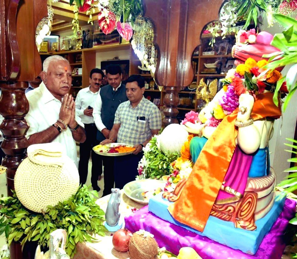 Karnataka Chief Minister BS Yediyurappa visits Maharashtra Chief Minister Devendra Fadnavis residence 'Varsha' for Ganesh Darshan in Mumbai on Sep 3, 2019. - B