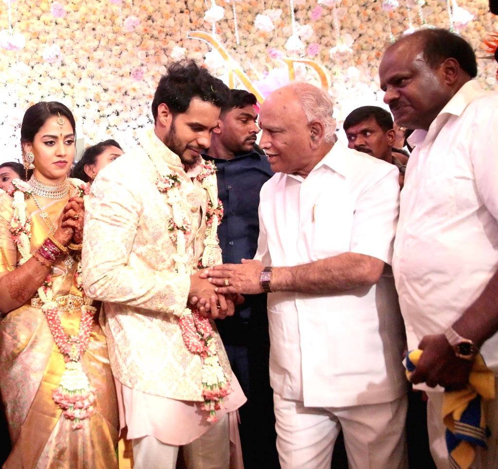 Karnataka Chief Minister BS Yediyurappa with Former Karnataka Chief Minister H. D. Kumaraswamy's son Nikhil and his fiancee Revathi during their engagement ceremony at the Taj West End in ... - B
