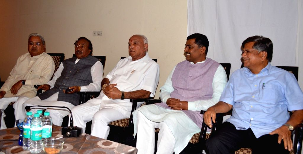 Karnataka Chief Minister BS Yediyurappa with BJP leaders Muralidhar Rao, Jagadish Shettar, KS Eshwarappa and others at the BJP legislative party meeting in Bengaluru on July 28, 2019. - B and Muralidhar Rao