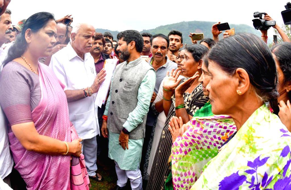 Karnataka Chief Minister BS Yediyyurappa visits rain hit areas at Mudigere Taluk in Karnataka's Chikkamagaluru district on Aug 27, 2019. - B