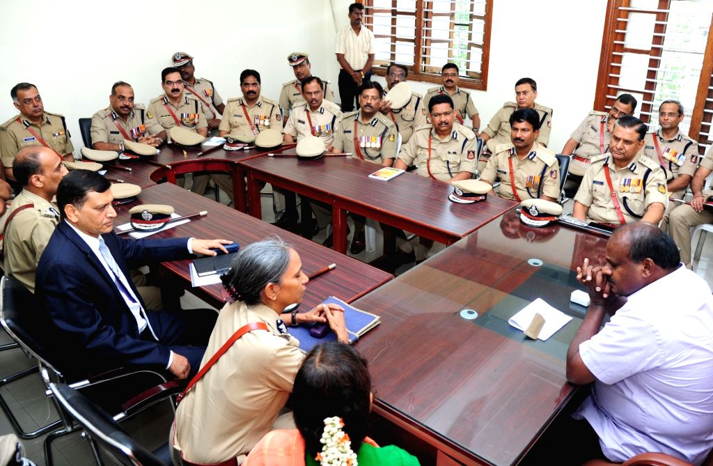 Karnataka Chief Minister H. D. Kumaraswamy interacts with state Director General and Inspector General of Police Neelmani N Raju during a meeting about the law and order situation in the ... - H. D. Kumaraswamy