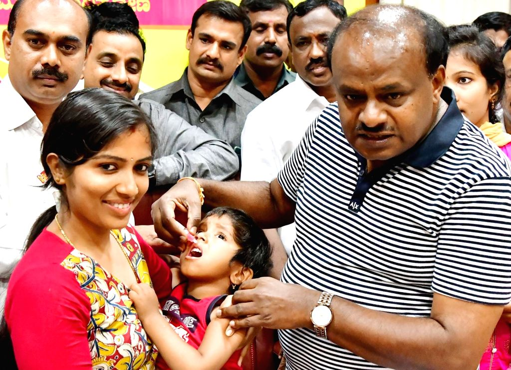 Karnataka Chief Minister H. D. Kumaraswamy administers polio drops to a child during Pulse Polio immunisation programme, in Bengaluru on March 10, 2019. - H. D. Kumaraswamy