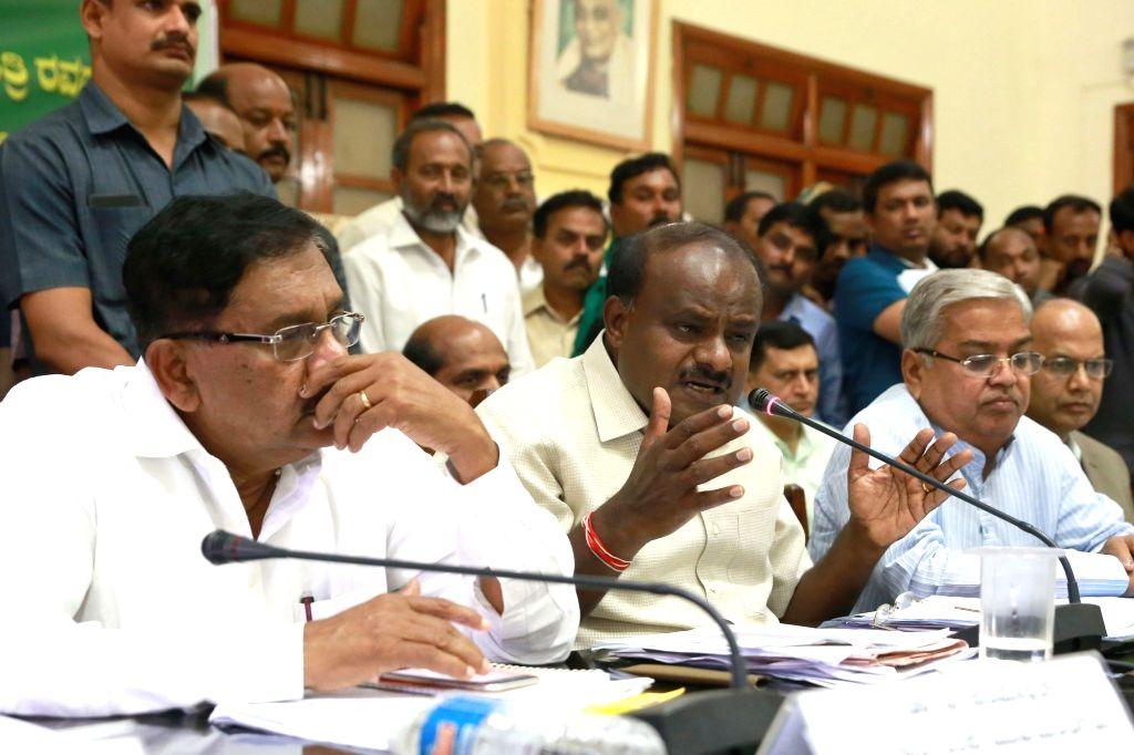 Karnataka Chief Minister H.D. Kumaraswamy and Deputy Chief Minister G. Parameshwara during a meeting with representatives of farmers from 30 districts over loans waiver, at Vidhana Soudha ... - H.