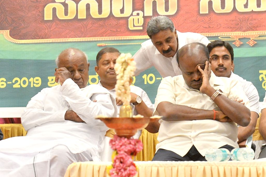Karnataka Chief Minister H D Kumaraswamy and JD-S supremo HD Devegowda during a party programme in Bengaluru on June 7, 2019. - H D Kumaraswamy