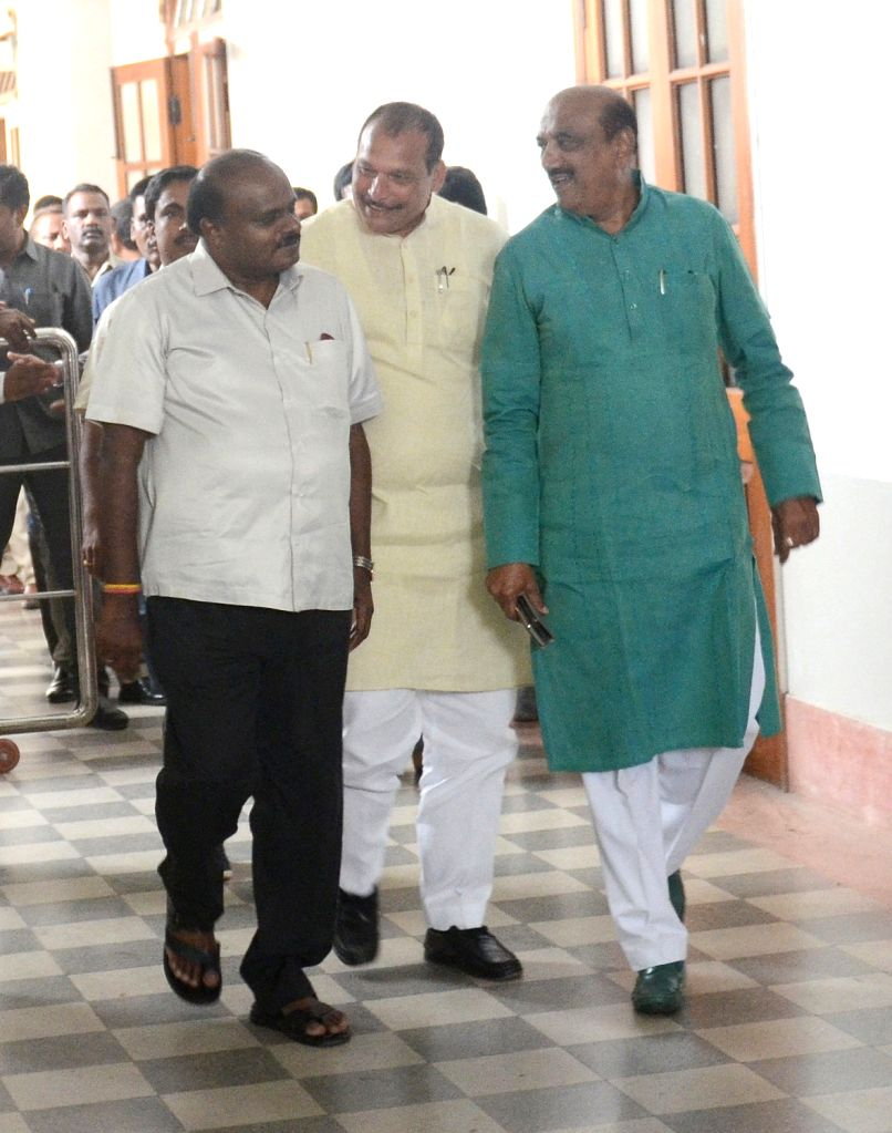 Karnataka Chief Minister H.D. Kumaraswamy arrives to meet state assembly Speaker K. R. Ramesh Kumar, at Vidhana Soudha in Bengaluru on July 17, 2019. - H.