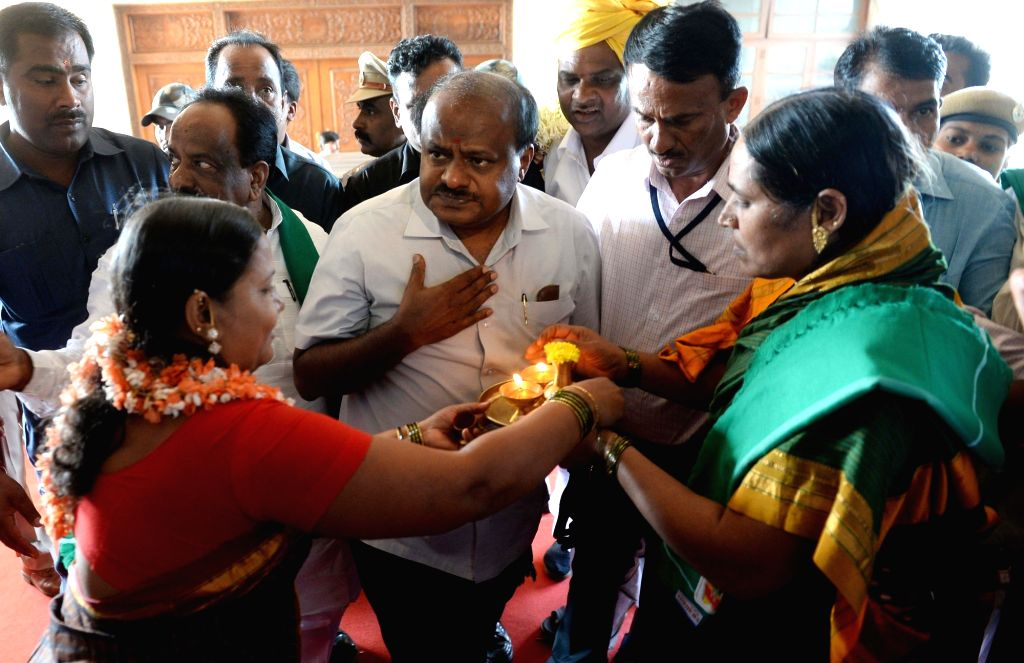 Karnataka Chief Minister H.D. Kumaraswamy being welcomed on his arrival on the first day of winter session of the state assembly in Belagavi of Karnataka's Belgaum district on Dec 10, 2018. - H.