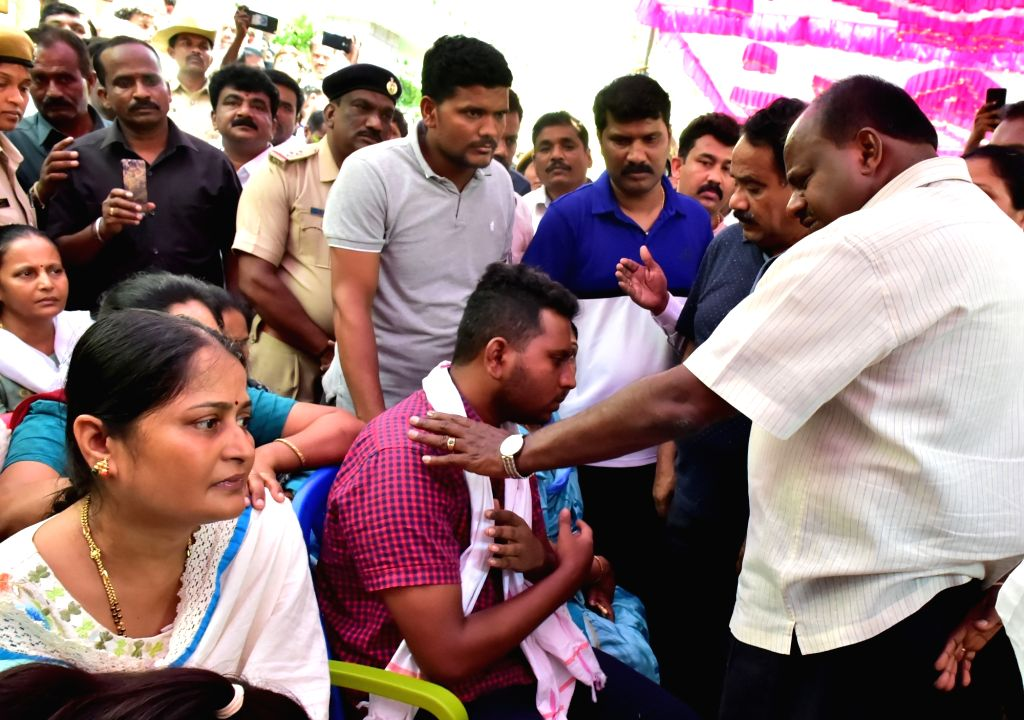 Karnataka Chief Minister H.D. Kumaraswamy consoles Chetan, son of K.G. Hanumantharayappa, one of the five Janata Dal-Secular (JD-S) members who were were killed in the Sri Lankan suicide ... - H.