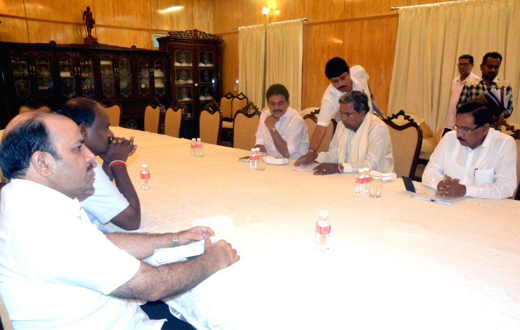 Karnataka Chief Minister H. D. Kumaraswamy, Deputy Chief Minister G. Parameshwara, Congress leaders Siddaramaiah and K C Venugopal and JD(S) Secretary General Kunwar Danish Ali during ... - H. D. Kumaraswamy