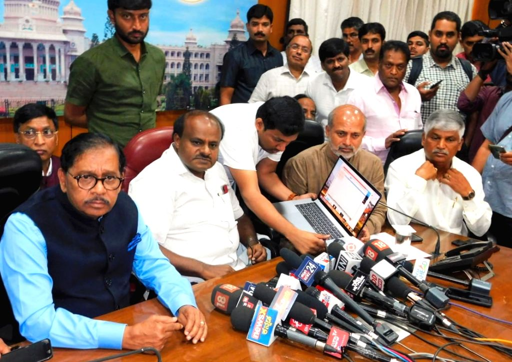 Karnataka Chief Minister H.D. Kumaraswamy, Deputy Chief Minister G. Parameshwara and state Tourism Minister Sa Ra Mahesh, at a press conference in Bengaluru, on Feb 8, 2019. - H.