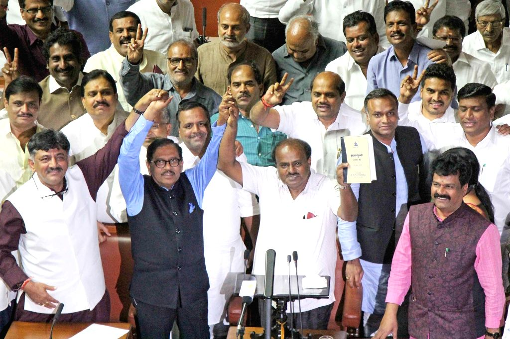 Karnataka Chief Minister H. D. Kumaraswamy, Deputy Chief Minister G. Parameshwara and Cabinet Minister D. K. Shivakumar during the Budget Session of the state assembly, in Bengaluru on Feb ... - H. D. Kumaraswamy