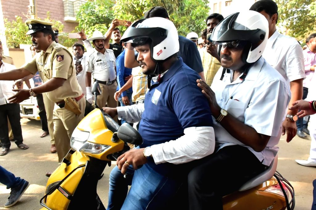 Karnataka Chief Minister H.D. Kumaraswamy flagged off the pilot project to deliver citizen services at home in Dasarahalli assembly segment in Bengaluru Rural district on March 2, 2019. - H.